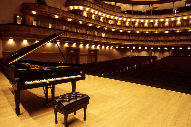 Steinway Model D Piano on the stage at Carnegie Hall, NYC, in preparation for a concert by Alfred Brendel.